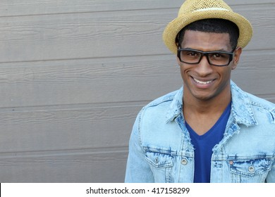 Close up Smiling Young Black Man Wearing Eyeglasses, Looking at the Camera Against Gray Wall Background with Copy Space