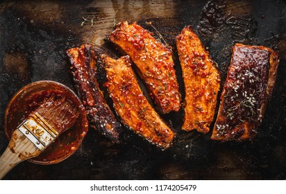 Close up of Smoked Roasted pork ribs. Barbeque spicy ribs. Traditional american BBQ food.