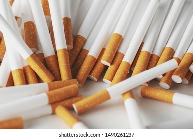 Close up of a smoking cigarettes . cigarette filter tubes