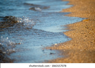 Close up of a smooth wave, beach and sand texture background