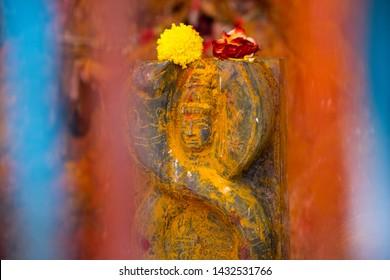 Close up of Snake Goddess - Naga Devata. Nagula Chavithi, a festival to worship Nag Devatas. Pamula Putta. Snake Hole. Snake House red colored mud or soil. Snake worship - Image