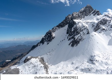Close up of snow mountain with bright blue sky