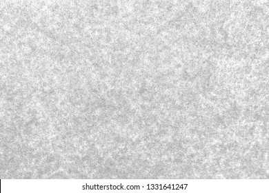 Close up snow white melange felt background. Surface of fabric texture in white winter color.