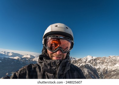 Close up of snowboarder with goggles and helmet