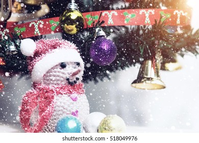 Close up the Snowman and Christmas decorations with light in vintage color.