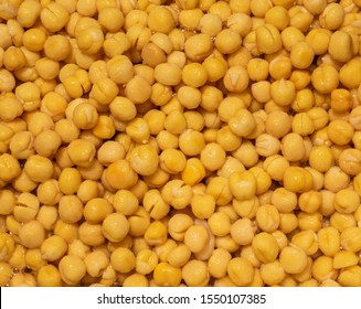 close up of soaked yellow peas in water.