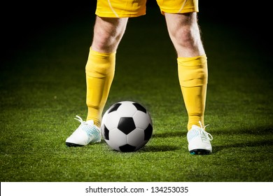 Close up of a soccer ball and a feet of a soccer player