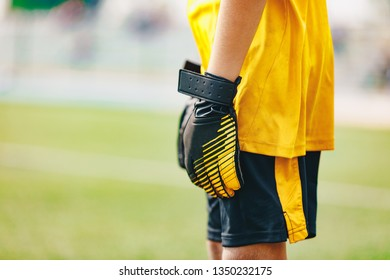 Close up of Soccer Gloves of Young Boy Soccer Goalie Standing in a Goal