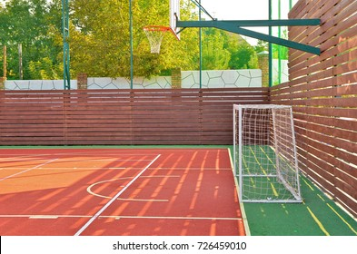Close up of a soccer goals on an outdoors mini football field with artificial cover.