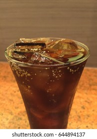 Close up soft drink with soda in glass with ice cubes