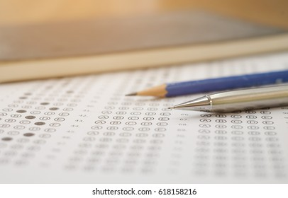 close up soft focus on Clutch-type pencil lay on exam sheet paper test paper:blur picture concept.