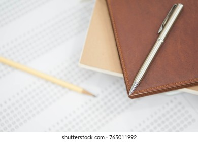 close up soft focus on Clutch-type pencil lay on notebook and exam sheet paper for iq test:blur picture concept.