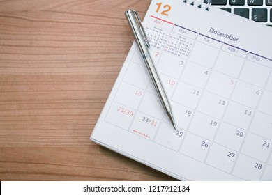 close up soft focus on pen and calendar 2018 on wood background table office desk with top view concept