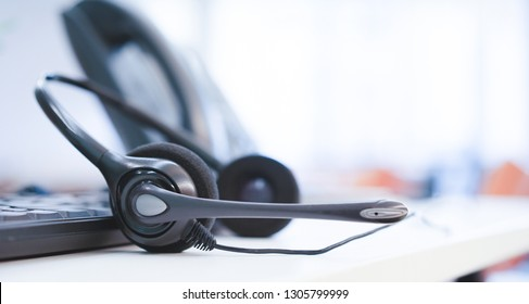 close up soft focus on telephone devices with copy space background at office desk in operation room for customer service support (call center) concept