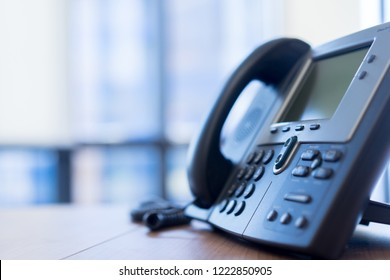 close up soft focus on VOIP telephone for network operation career stand on office desk, advance technology telecommunication concept