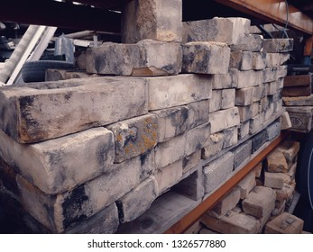 Close up of soft yellow bricks at a salvage yard in the UK.