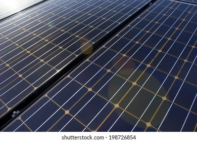 Close up of  solar panels with light flare