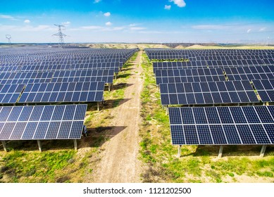 Close up of solar photovoltaic panels overlooking industrial area