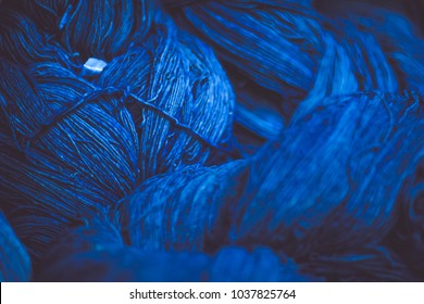 A close up of some deep blue cotton reels, Cotton dye indigo. Indigo is made from natural ingredients. in Thailand, cotton texture, use for background.