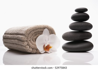 close up of spa treatment luxury treatment with hot stones and orchid