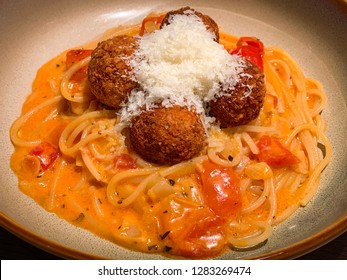 Close up of spaghetti cheese balls. Traditional Italian spaghetti and meatballs homemade.