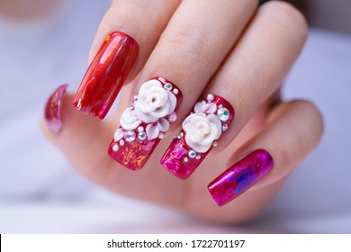 close up sparkling red color gel polish painting beautiful 3D rose flower decorate d with shiny rhinestone and glitter on fashionista woman long square shape acrylic fingernail