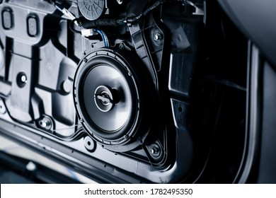 Close up the speaker on the car door during installation. Car audio installation concept.