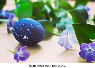 Close up of speckled blue Easter egg