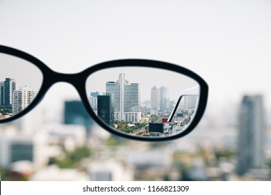 Close up of spectacles on blurry city background. Clean vision concept.