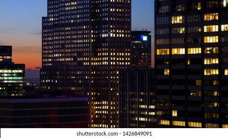 CLOSE UP Spectacular shot of skyscrapers in New York lighting up at sunset. Breathtaking view of metropolitan city skyline on colorful autumn morning. Towering high rise buildings of Manhattan at dawn