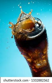 Close up of a splash on a Cola drink