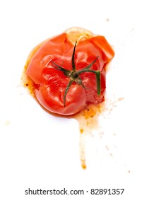 close up of  a splattered tomato on white background