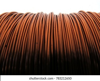 Close up of spool with copper wire, horizontal, chaotic, non-evenness