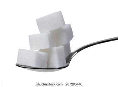close up of a spoon with sugar cubes on white background.