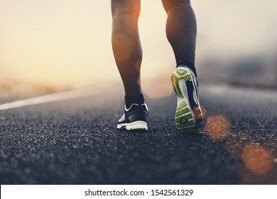 close up sport shoes of a runner on road for fitness healthy lifestyle.