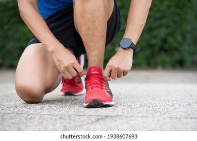 Close up of sportsman tying shoelace.Get ready to start exercising or running.healthy lifestyle concept.