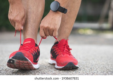 Close up of sportsman tying shoelace.Get ready to start exercising.healthy lifestyle concept.