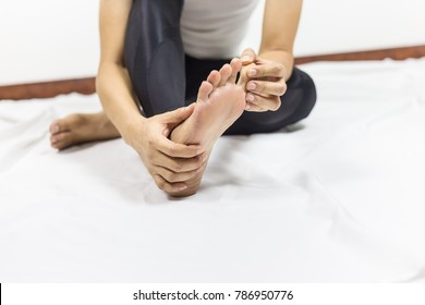 close up  sporty man feeling pain of toe during sport workout indoor room at fitness club