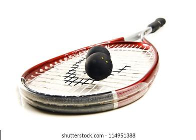 Close up of a squash racket and balls