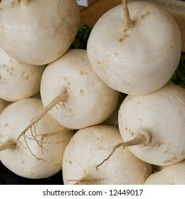 Close up of a stack of big white round Japanese kabura turnips which are famous in the Kyoto region of Japan.