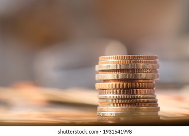 Close up stack of coin on table background and business or finance saving money