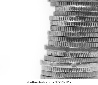 Close up stack of coins in black and white.