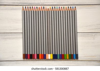 Close up stack colour pencils on wooden background