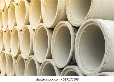 Close up stack of concrete drainage pipes for wells and water discharges