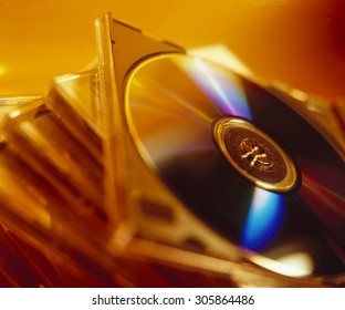 Close up of a stack of DVDs with orange gel lighting