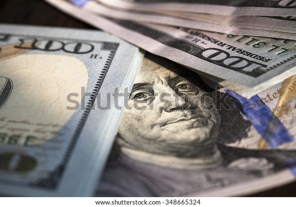 Close up of stack of one hundred dollar bills.