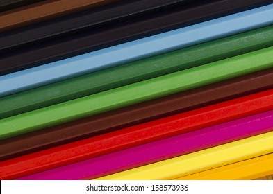 close up of a stack of pencil crayons in many colors creating background