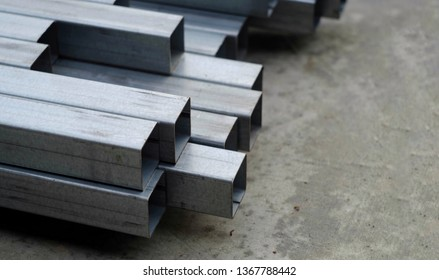 close up stack of square steel tube for industry, industrial business technology concept