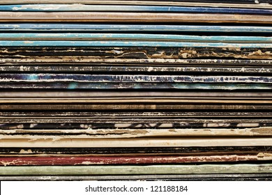 Close up stack of vintage vinyl records in sleeves