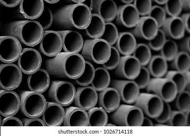 close up stack of water pipe for industry background, black and white tone